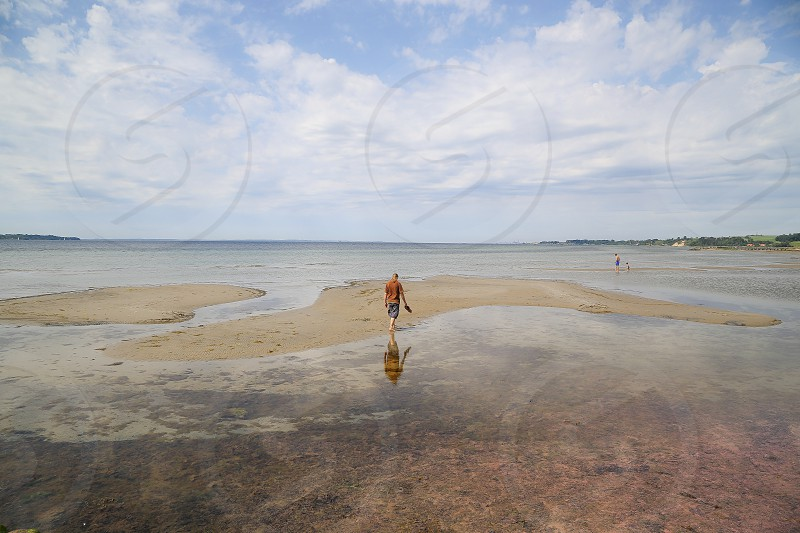 Man walking in polluted water photo