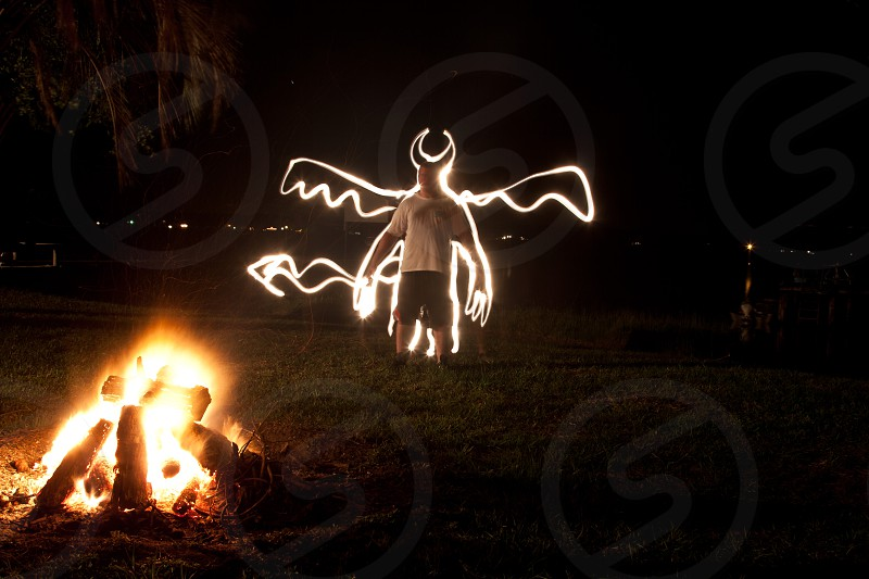 Light writing around the campfire at the lake.  An evening of light writing charades became very imaginative photo