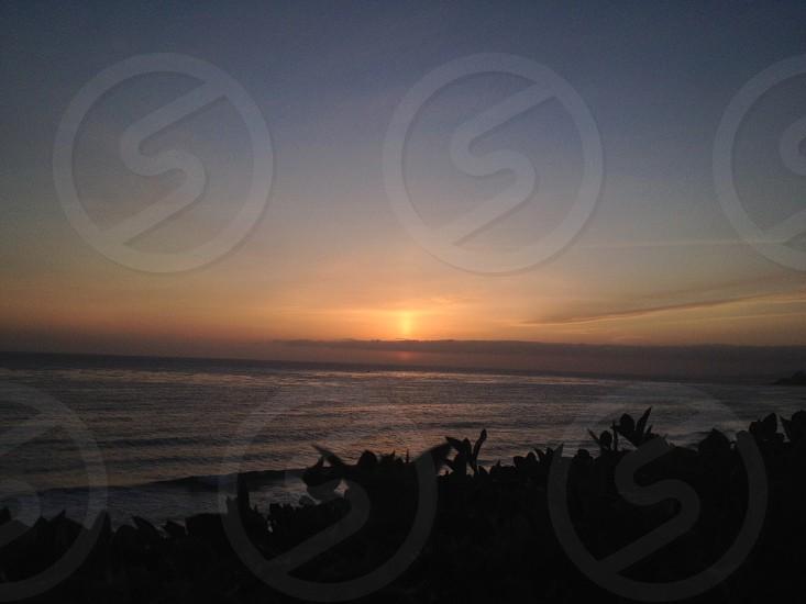 orange sunset by the sea photo