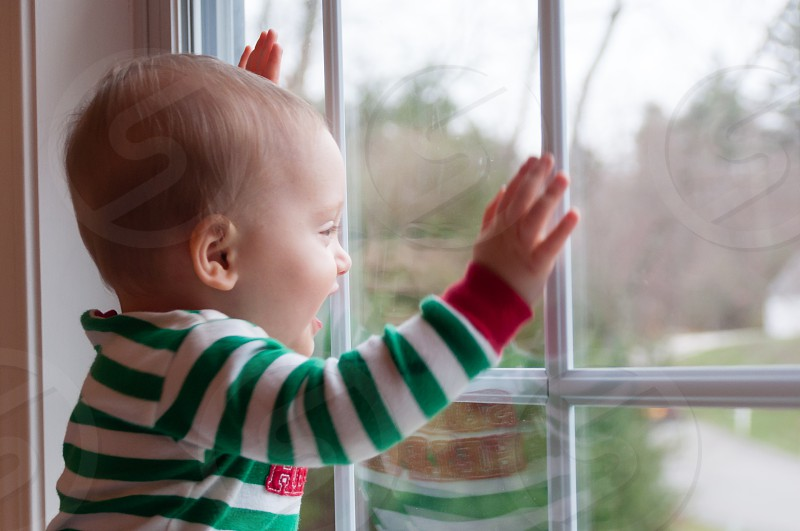 Happy baby reflected in window photo