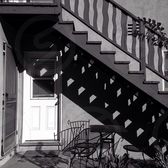 portrait view of door and stairs of house photo