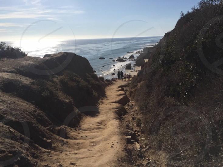clay trail to the beach shore photo