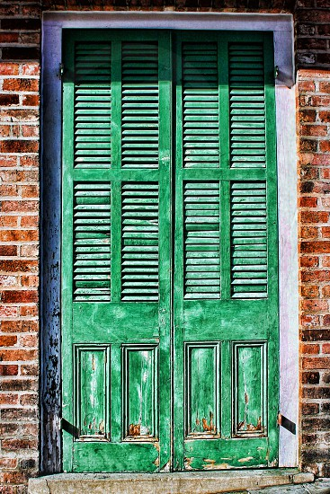 Old wooden green louver door in the French Quarter of New Orleans photo