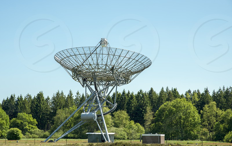These antenna can be individually directed at any point on the sky. the dishes have a fixed locationWesterbork measures in wavelengths of 3.6 cm to 2.5 meter. photo