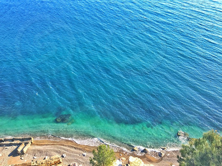 aerial photo of blue body of water near shore during daytime photo