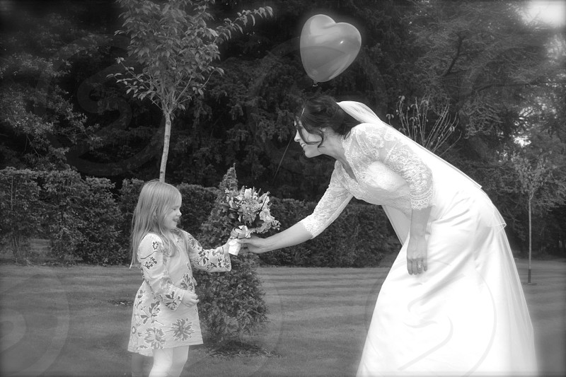 Young girl with bride. Balloon. Black and white.  photo