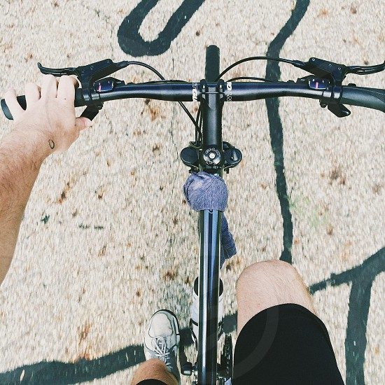 person in black short riding gray mountain bike photo