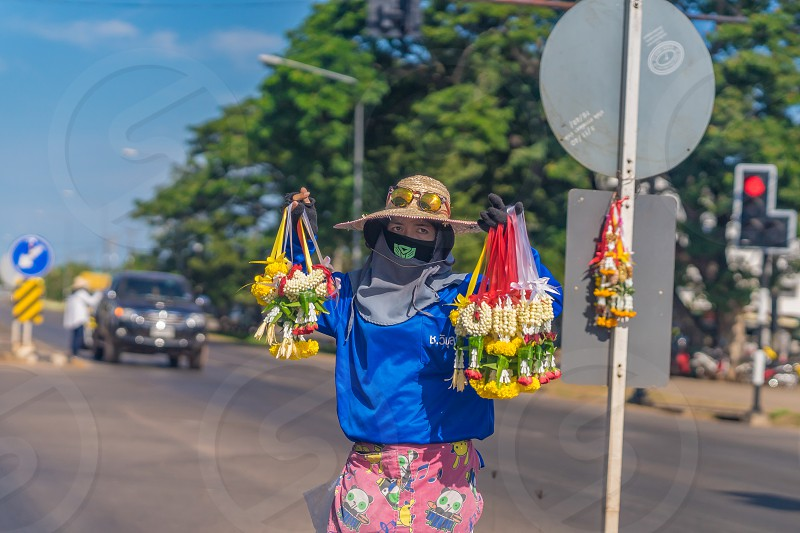 A flower vendor on a road in Thailand. photo
