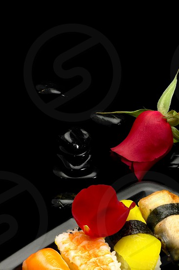 fresh assorted colorfull sushi plate over black photo
