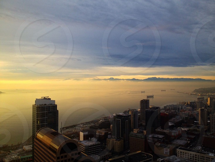 aerial city view with ocean and sunset view  photo