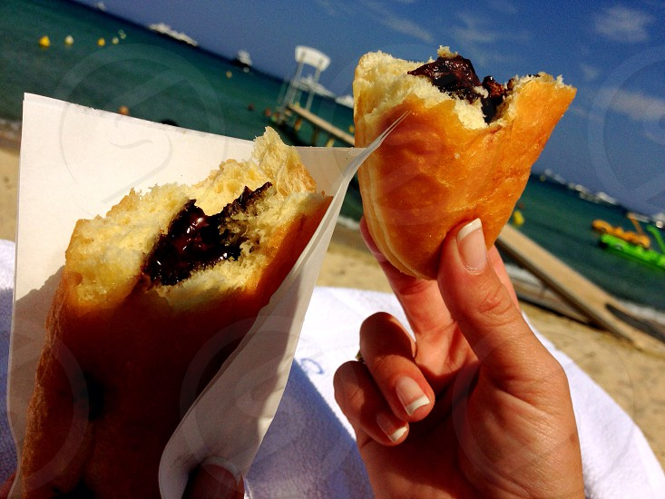 Beignets. Pastry. Donuts. Beach. French Riviera. St. Tropez. Ocean photo