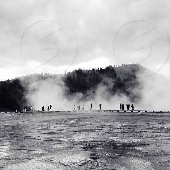 Walking among the steam in Yellowstone photo