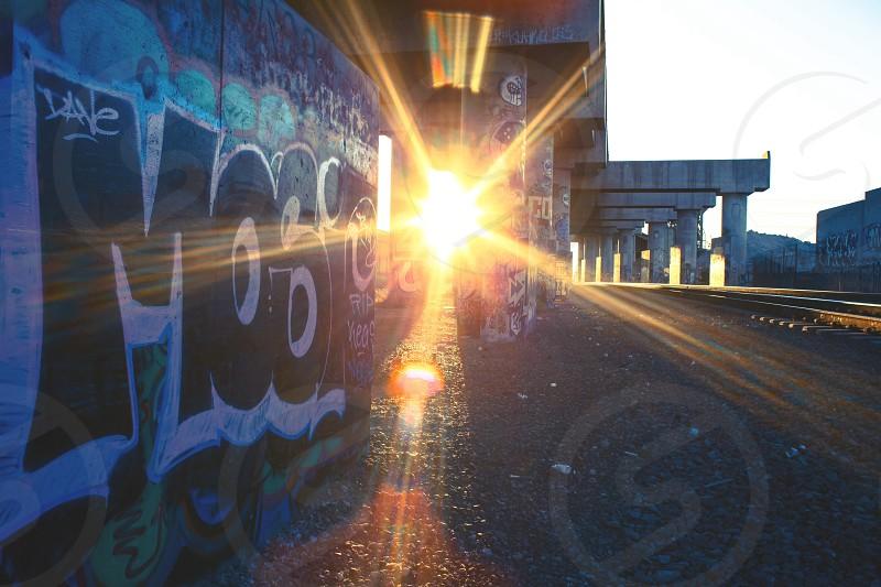 lens flare sun sunset city wall urban grafitti art railroad tracks hidden photo