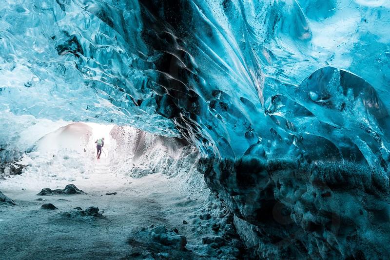 Winter adventures inside an ice glacier Iceland  photo