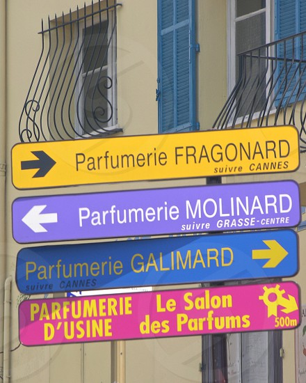Road signs indicating the routes to famous parfumeries in Grasse France. photo