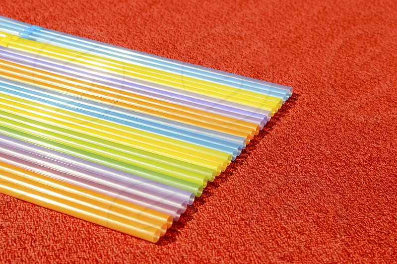 Straws in line red background photo