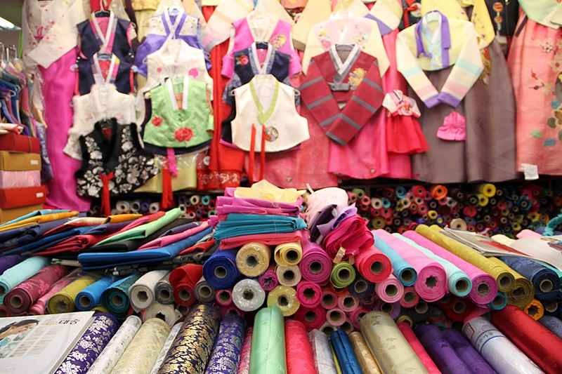 Textiles stand in a market Daegu South Korea. (colours hanbok traditional dress) photo