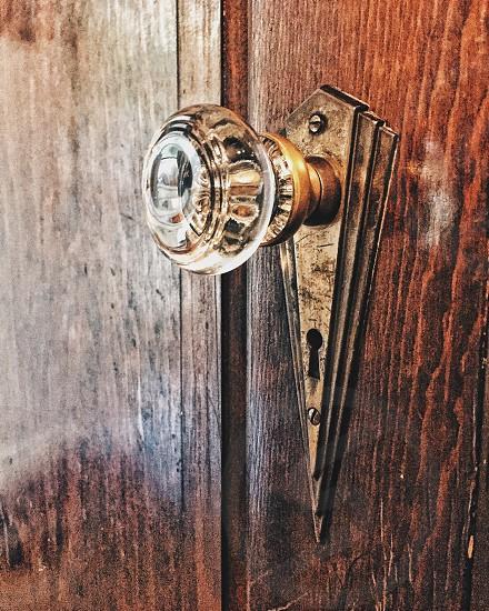 Door knobdoor handledoorantiquevintageretrobronzemetalkeykey holeproductobject photo