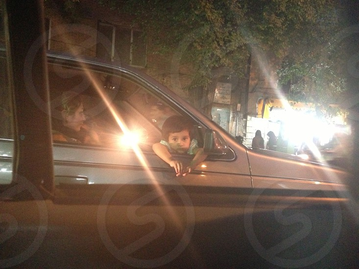 boy sitting inside the gray passenger vehicle photo