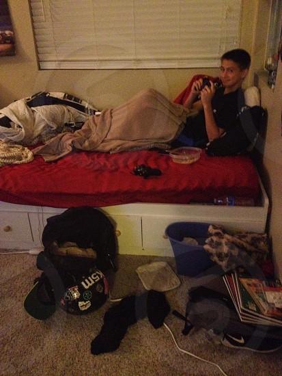 Teenage boy in dirty room photo
