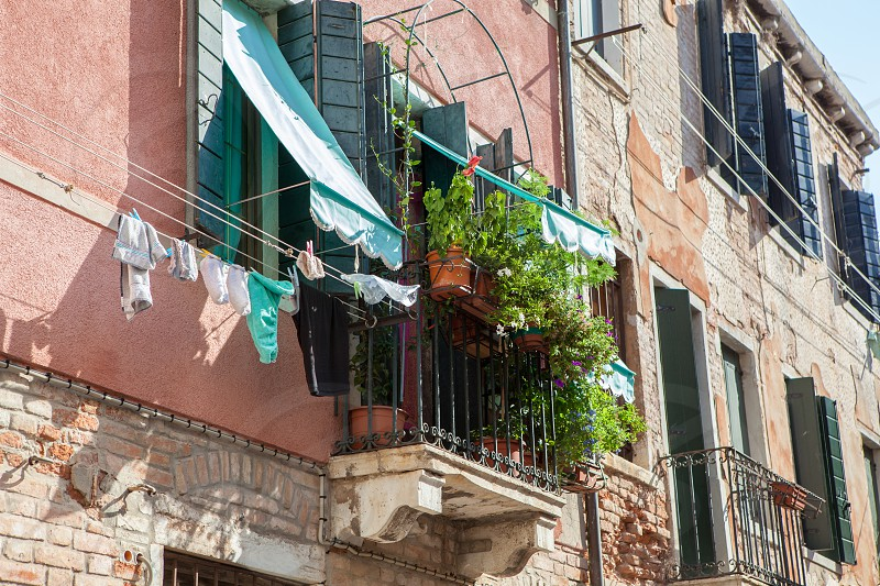 Upper circle or balcony represented in one of Venetian buildings in Italy. Beautiful and gorgeous traditional house. photo