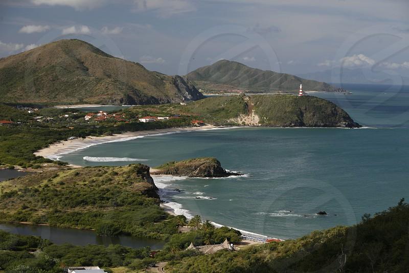 the Coast with the beach Playa Pedro Gonzalez in the town of Pedro Gonzalaz on the Isla Margarita in the caribbean sea of Venezuela. photo