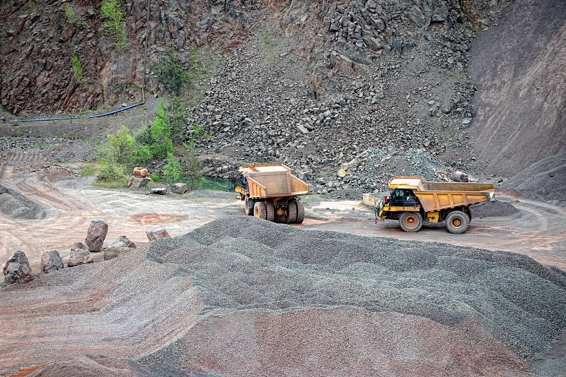 two dumper trucks in a quarry. mining industry. photo