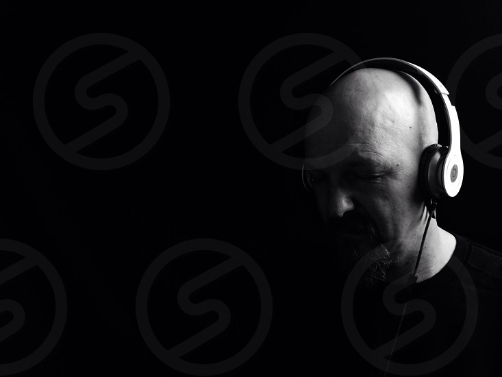 person wearing headphones in grayscale photo