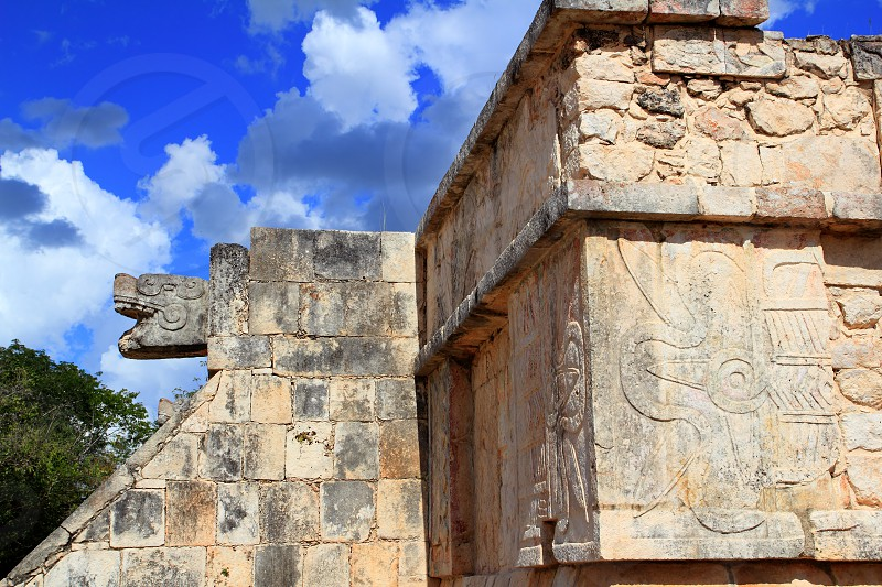 Chichen Itza hieroglyphics Mayan sculptures in Mexico Pyramids photo