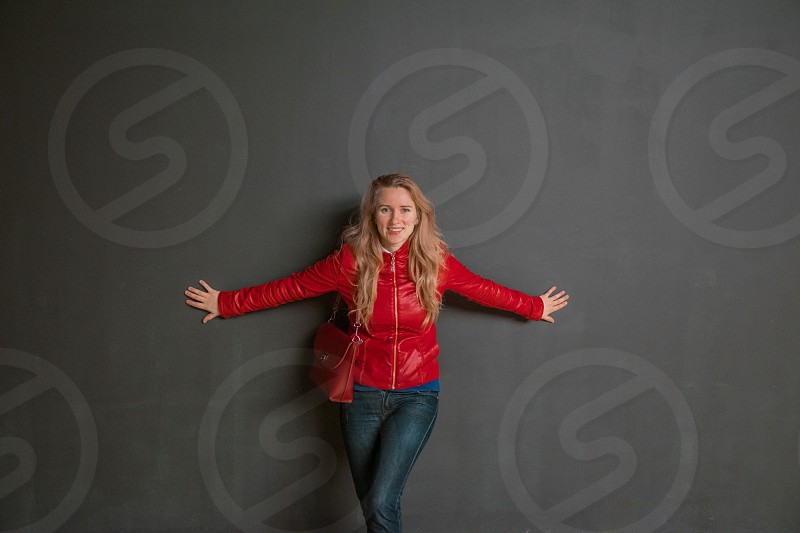 woman wearing red zippered jacket taking a photoshoot photo