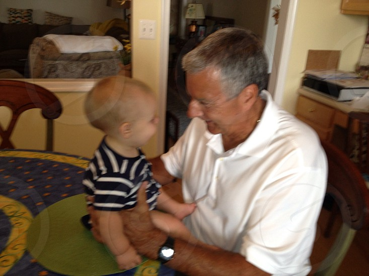 Grandfather and grandson sharing a moment photo