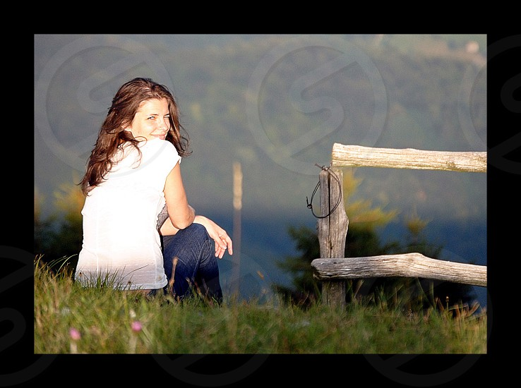 woman in white t shirt sitting photo