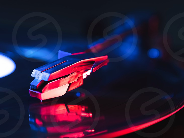 Cinemagraph retro record vinyl player. Record on turntable. Top view close up. Loop-able Vintage photo of Old Gramophone playing a music photo