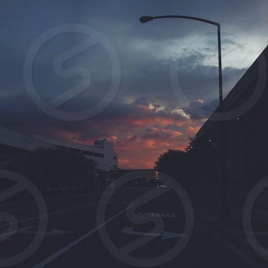 light post beside asphalt road during dawn photo