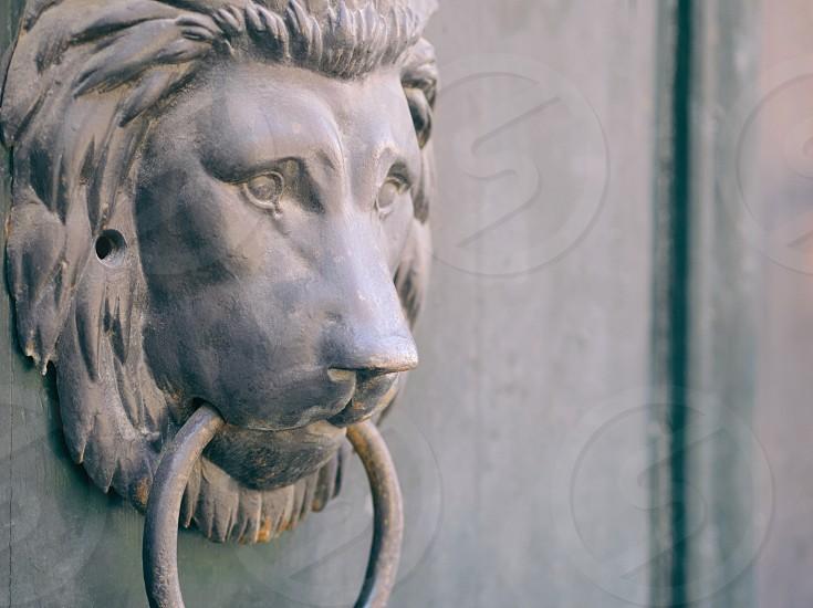 Traditional Old Bronze Lion Head Knocker Closeup photo