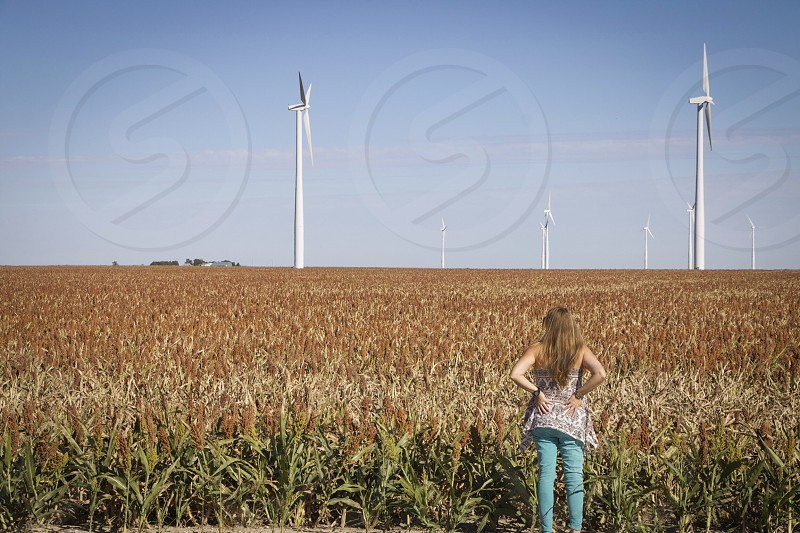 woman in blue pants and tube top at a corn field photo