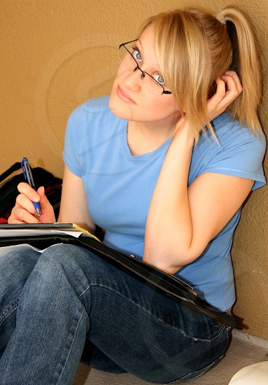 Attractive young woman studying photo