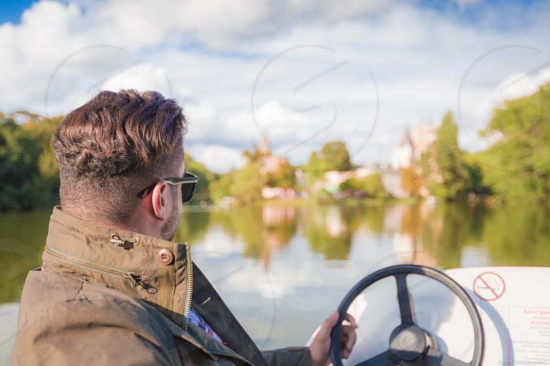 man riding bow rider photo