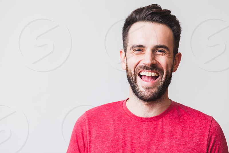 Portrait of a handsome young man laughing photo