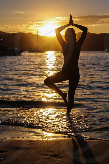 Yoga sunset water photo