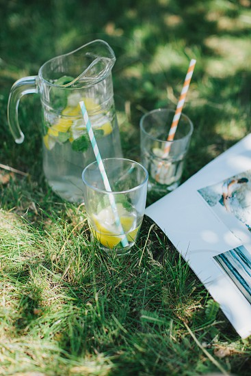 clear drinking glass with straw near clear glass pitcher photo