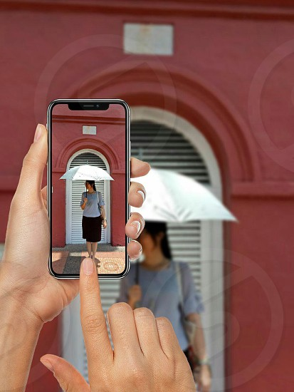 taking a photo of a woman using mobile phone photo
