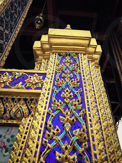 Outdoor day vertical portrait colour Grand Palace Bangkok Thailand Asia East eastern Far East temple Shrine monument mosaic tile tiles colourful gold golden gold leaf decorative king royal regal travel tourist tourism wanderlust Buddhist Buddhism ornate pillar photo