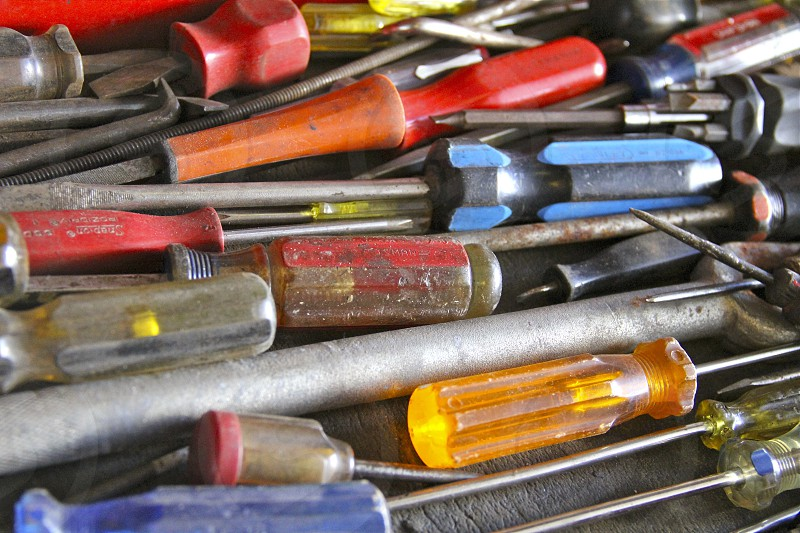 The choice is yours - a drawer of various colored sizes and types of screwdrivers.  photo