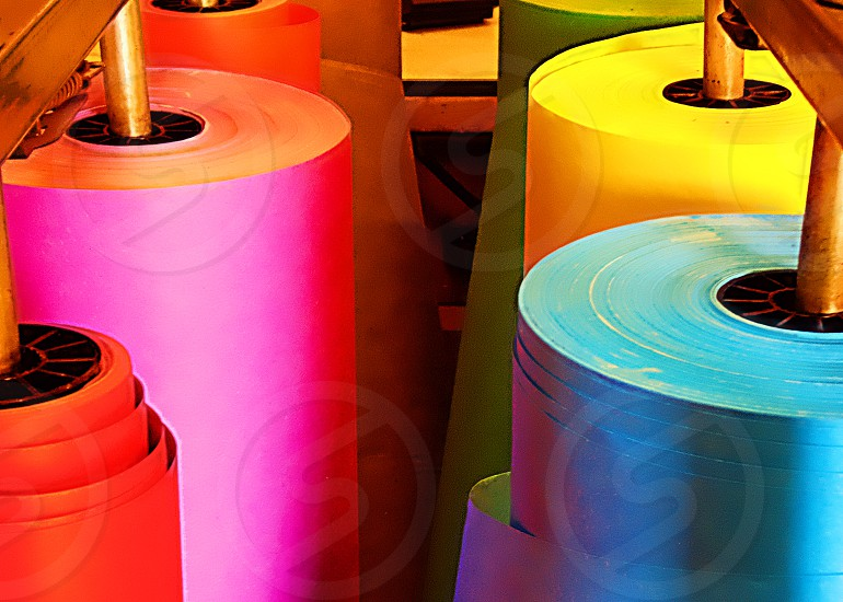Rolls of colorful butcher paper fstand upright photo