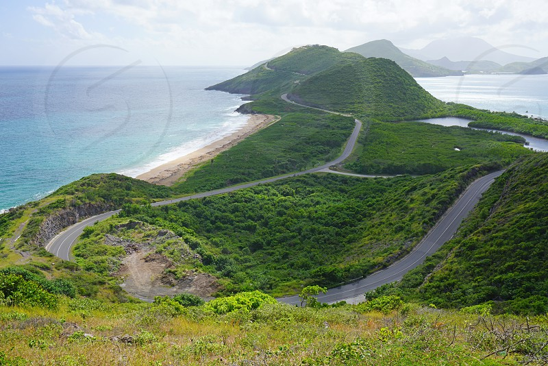 Driving between the Caribbean Sea and the Atlantic Ocean on the island of St Kitts in St Kitts and Nevis photo