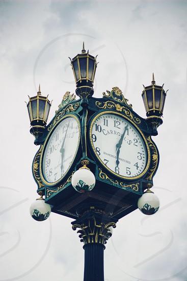 black metal four faced clock photo
