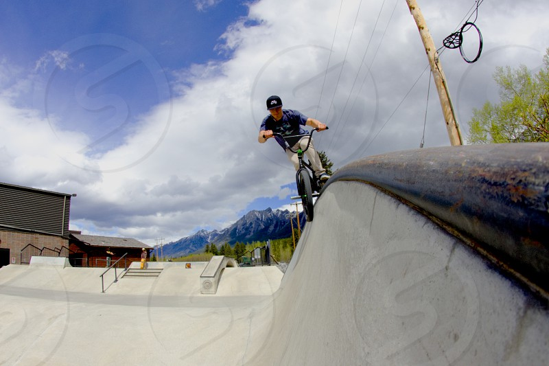 Grinding the coping at the skate park in Canmore Alberta. photo
