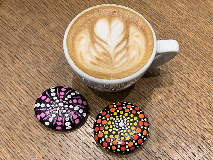 Italian cappuccino with two stone mandala for a colorful breakfast photo