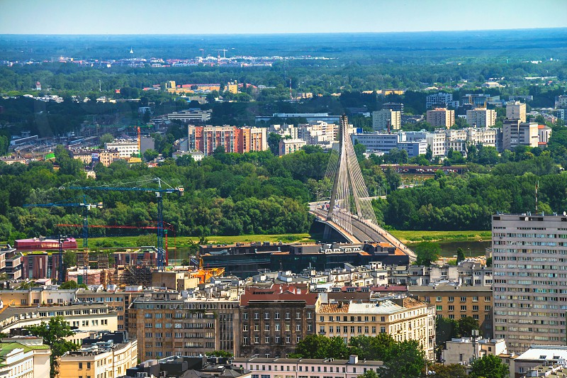 Aerial view of the Warsaw skyline buildings including Swietokrzyski Bridge over the Vistula river. photo